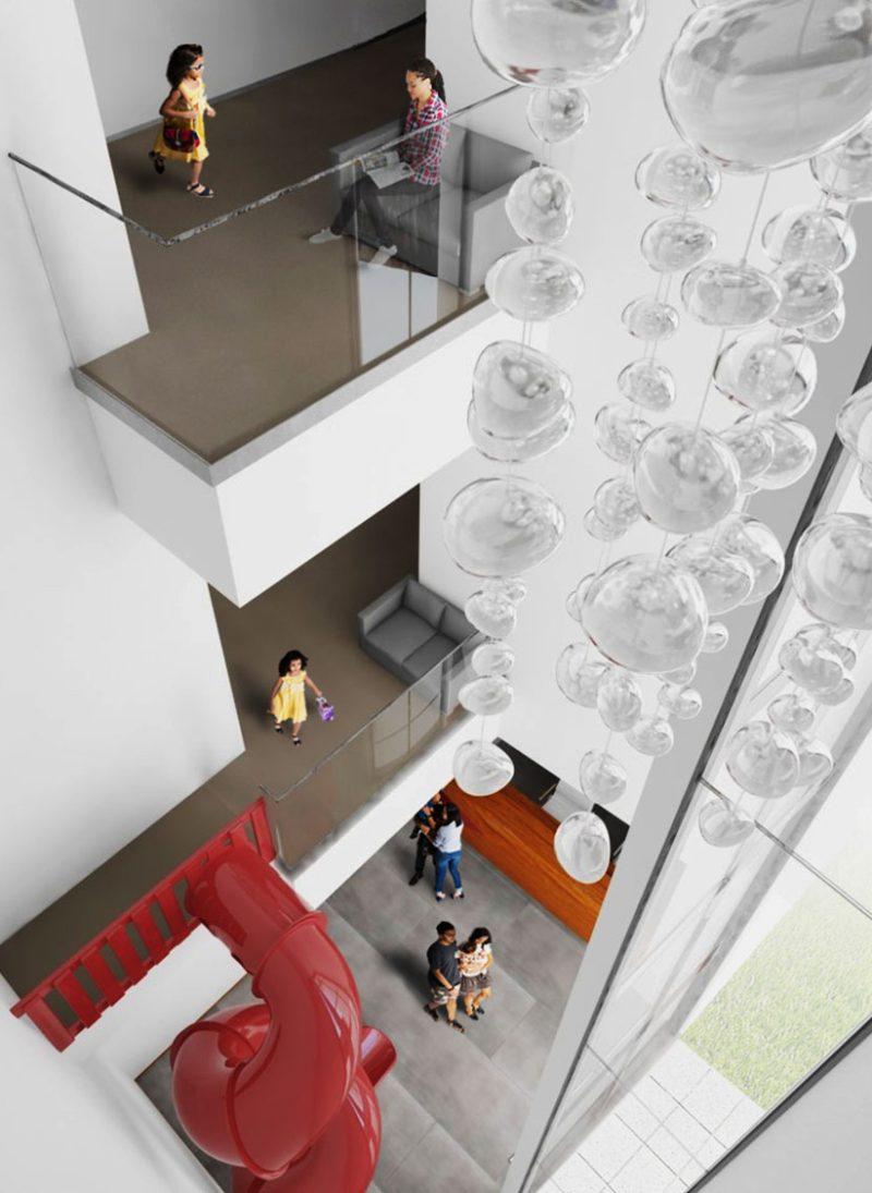 Aprender a brincar através da arquitetura da escola. Escorrega que liga o piso do andar com o res do chão. Colégio Aldancas projeto Obra Atelier